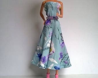 Wide, backless Barbie dress in bright turquoise with flowers design