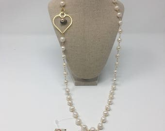 Long necklace with white pearls, gold heart, and small colored pearls