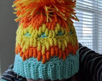 Crochet Orange, Yellow and Blue Beanie with large Pom Pom.
