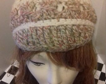 Chunky cream and green flecked knitted woolly beanie hat with peak.