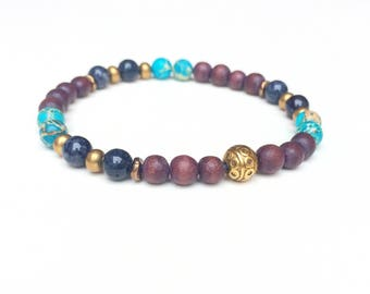 Men's stretch beaded yoga bracelet. High quality gemstones and wooden beads. Nickel-free.