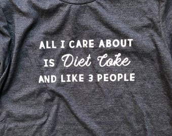 all i care about is diet coke and like 3 people women's super soft t-shirt
