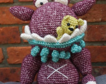 crocheted monster with bear