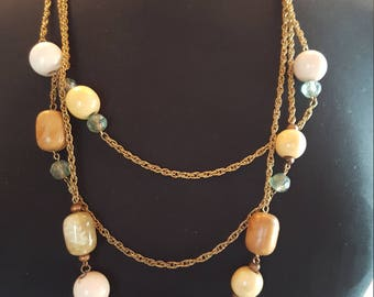 Large wooden beaded necklace with 3 strands.