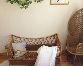 Vintage rattan baby bed