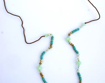 Emerald fine necklace with tassels