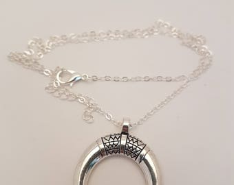 silver necklace with half moon charm.