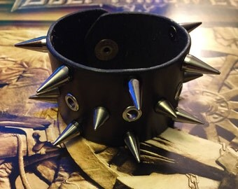 Spiked leather cuff w/ eyelets