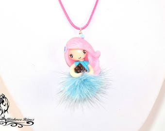 Doll made of polymer clay with tassel necklace