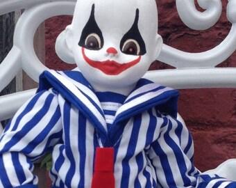 Creepy Clown in Blue stripes.