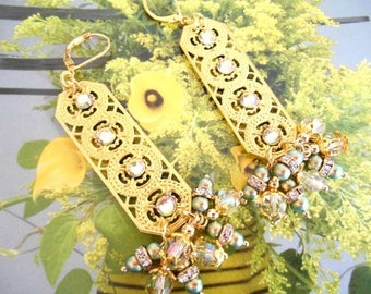 Earrings long gold charm, beads and green Crystal rhinestones.