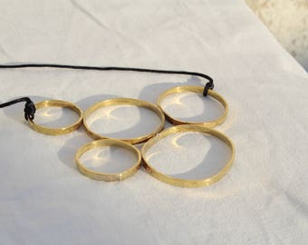 Circles of Life and Luck Made With Brass