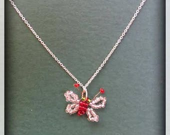 Red and silver beaded butterfly necklace