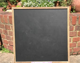 Large chalkoard or blackboard with chalk tray