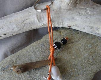 Door keys or jewelry bag in orange and black wood