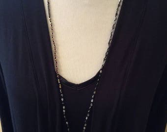 Handknotted necklace made of small, faceted, teardrop-shaped, fire polished czec glass beads with an irridescent finish.