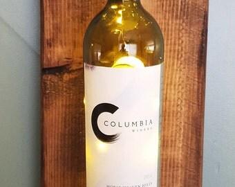 Illuminated wine bottle sconce