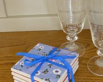 Handmade pretty flower ceramic coasters. Set of four.