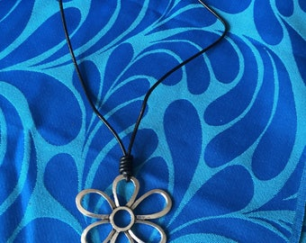 Daisy pendant on leather necklace
