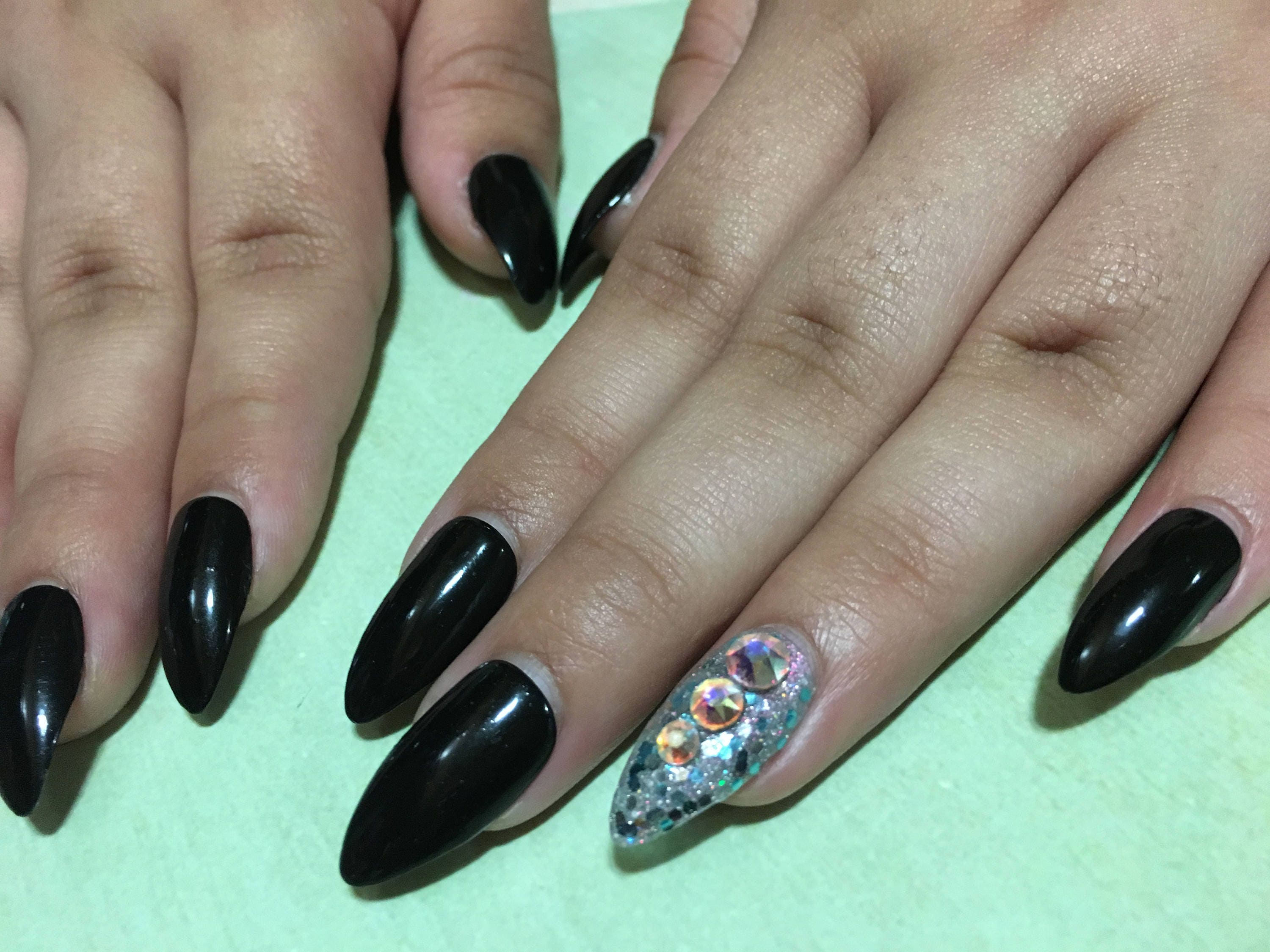 Black stiletto nails with real Swarovski crystal accent nail