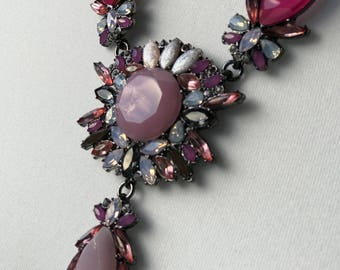 Bib style statement necklace in shades of pink