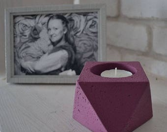 Concrete candle holder with tealight candle