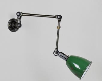 A Wall Mounted Task Lamp by Dugdills. Made in England. Circa 1940s.