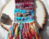 Small Weaving with Hand Spun Wool, Silk, Mohair, Sparkle in blue and red tones with yellow, orange, green