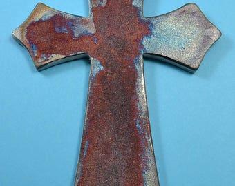 Ceramic cross fired in a Raku kiln to create copper highlights