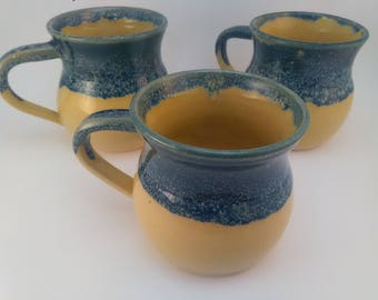 Set of three coffee mugs. Wheel thrown and glazed fired to cone 5.