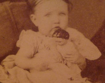 Antique Carte de Visite of Infant with Center Part Holding China Head Doll