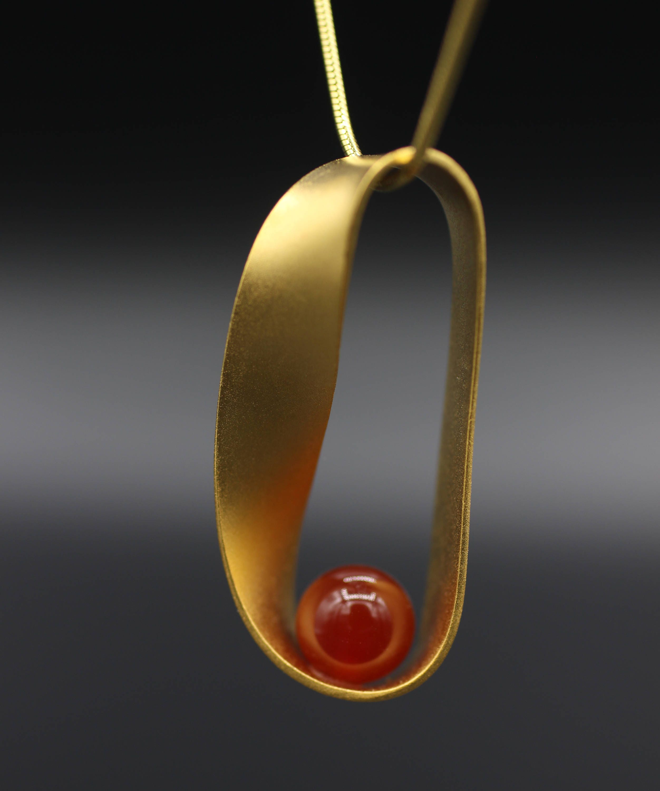 Mobius strip necklace yellow gold platedcarnelian mozeypictures Image collections