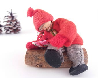Vintage Scandanavian Christmas Ornament Figurine, Boy Sitting on a Log with a Christmas Gift, Vintage Hand Made Miniature Doll Figurine