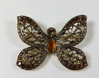 Gold Tone Aluminum Butterfly Brooch with Amber Rhinestones