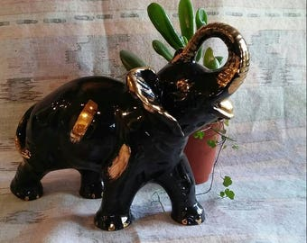 Black and gold ceramic elephant lucky