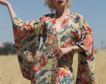 Vibrant 1940s silk kimono robe, dressing gown, Japan, cranes and other abstract imagery.