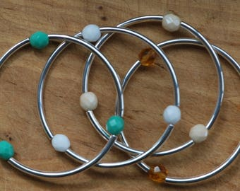 Br-19-22 Elastic bracelets that look like bangles, made of three silver tubes and three Czech faceted glass beads; choice of bead colour