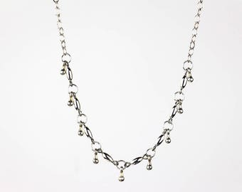 Delicate Silver Beaded Necklace with Teardrop Dangles