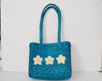 Blue straw bag with white flowers