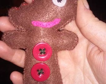 bitten gingerbread man with a smile ornament