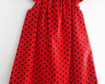 Size 1 Girls red and black ladybird Dress with Flutter Sleeves and pom pom trim. black dots spots