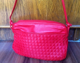 Red woven leather handbag  by Oroton