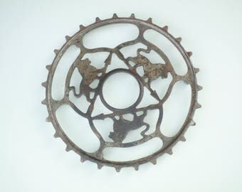 Vintage and Rare French  Iron Trivet made by Peugeot with bike chainring     Kitchen table