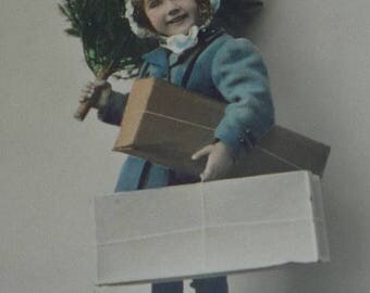 ON SALE till 7/28 Little Girl With Tree and Packages Antique Christmas Postcard.
