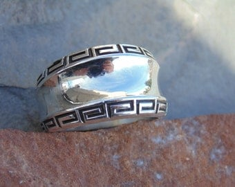 Kabana ~ Sterling Silver Greek Key Edged Ring with Concave Center - Size 7.75
