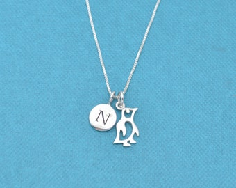 "Little girl's penguin necklace in sterling silver on a 14"" sterling silver chain and personalized with a sterling silver initial charm."