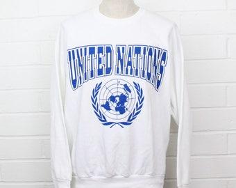 Vintage 1990s United Nations Emblem 90s White Size XL Crew Neck Sweatshirt