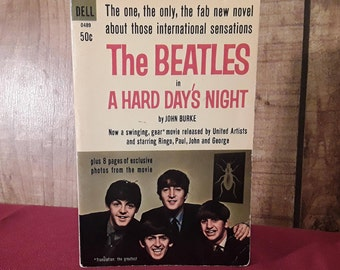The Beatles  Paperback Book - A Hard Day's Night 1964,First Dell Printing, 8 pages of photos, Movie Book, Ringo, John , Paul, George