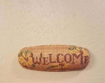 Vintage oval wall basket with WELCOME in needlework.  Sunflower needlework wall basket. 16x6x3