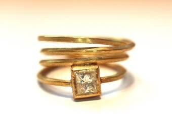 Gold wrap ring with princess cut diamond